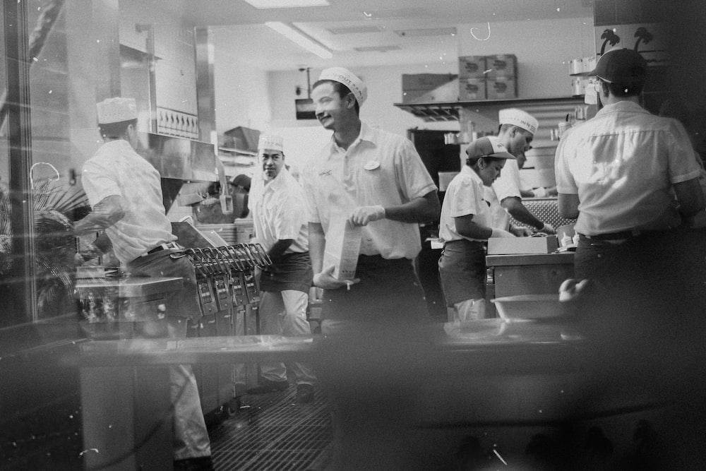 grayscale photo of man in white chef uniform
