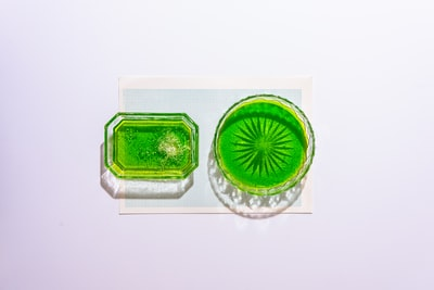 green and white plastic container emerald green zoom background