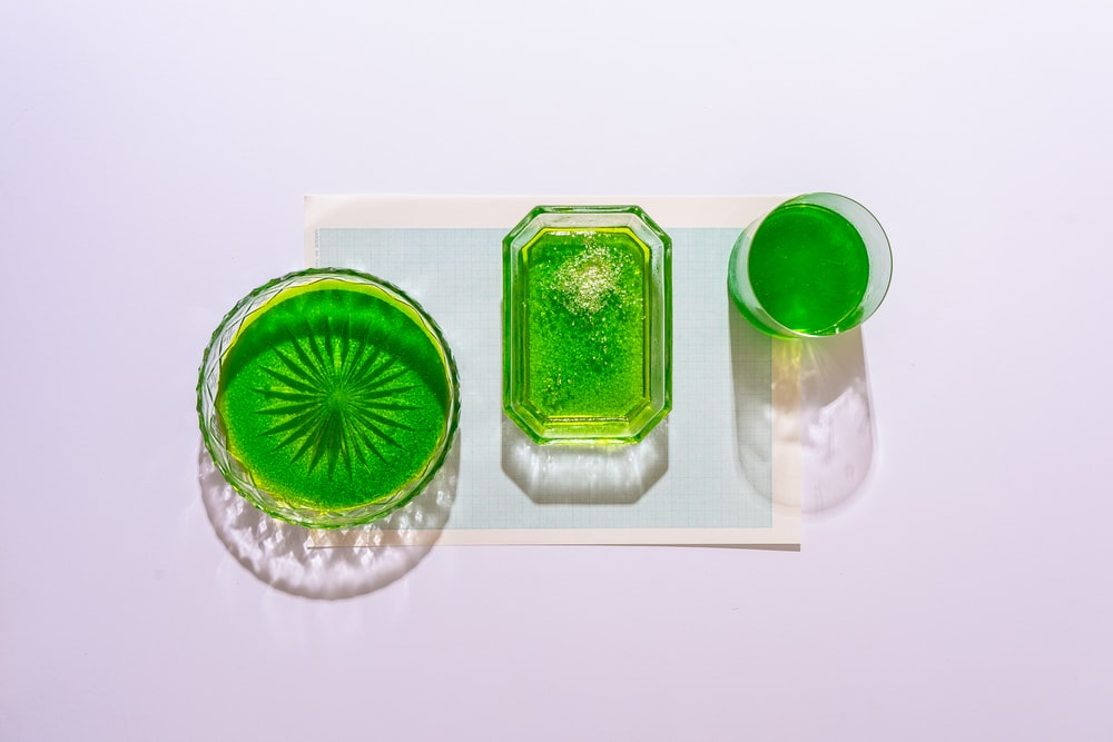 green and clear glass container