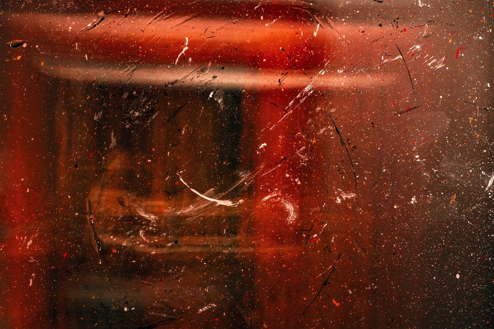red light on brown wooden surface