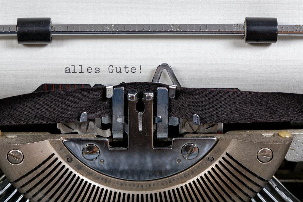 blue typewriter on white table
