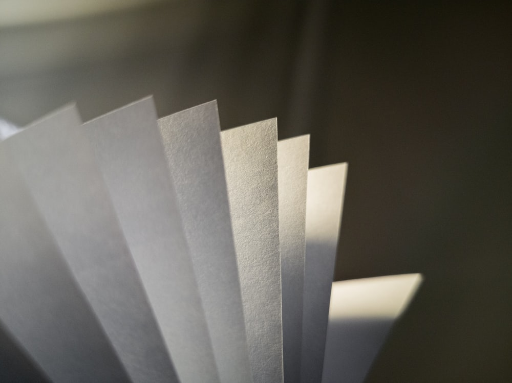 white paper on gray surface