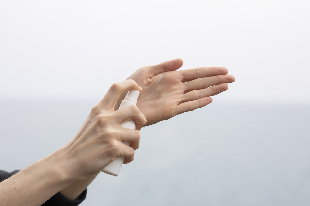 person doing hand sign during daytime