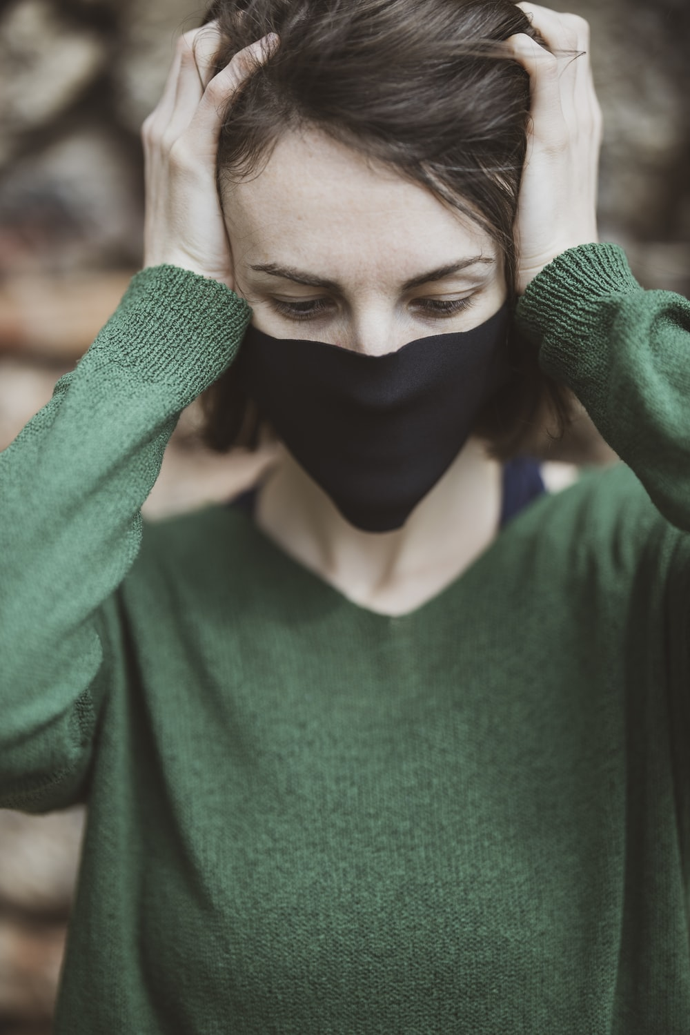 woman in green v neck sweater