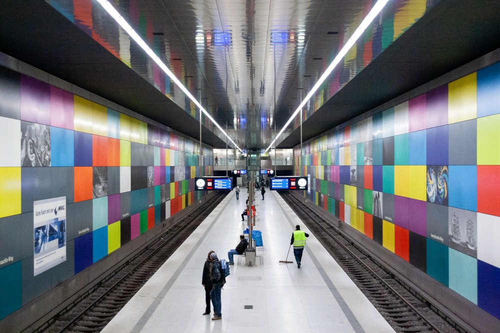 people walking on tunnel during daytime