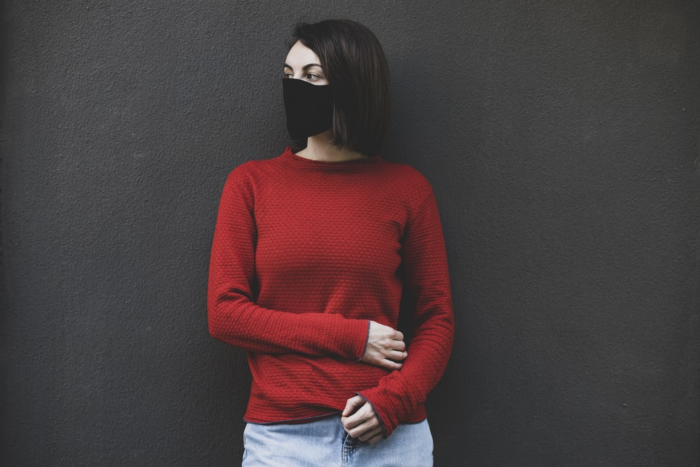 woman in red sweater and blue denim jeans