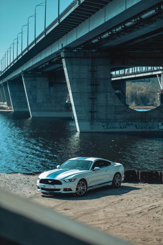 silver porsche 911 parked near bridge during daytime