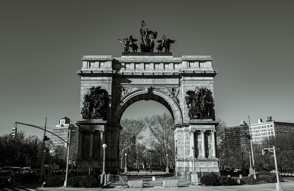 grayscale photo of man riding horse statue