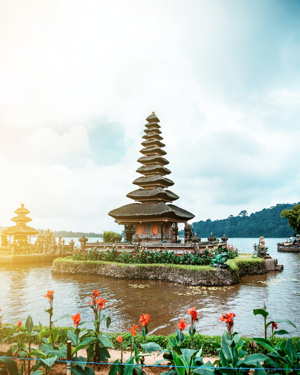 brown and white temple near body of water during daytime