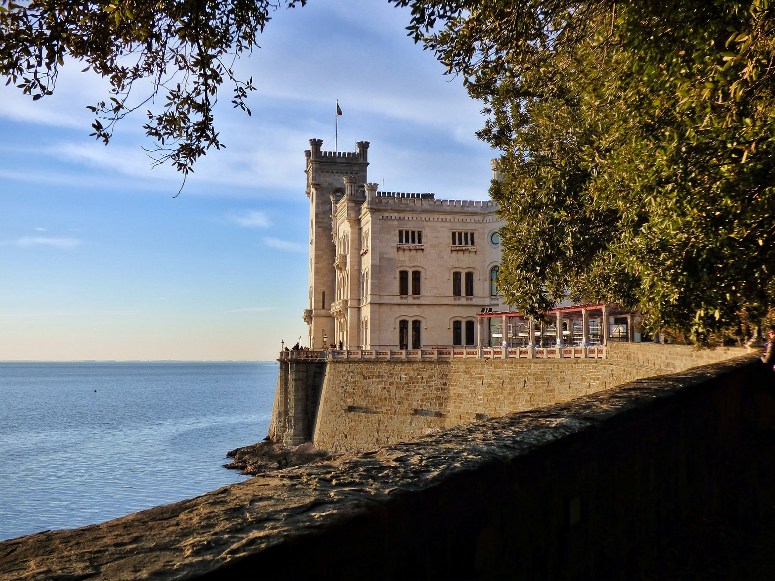 a building by the sea in Trieste, Italy