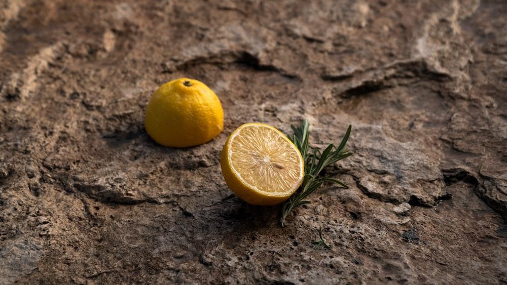 yellow lemon fruit on brown soil