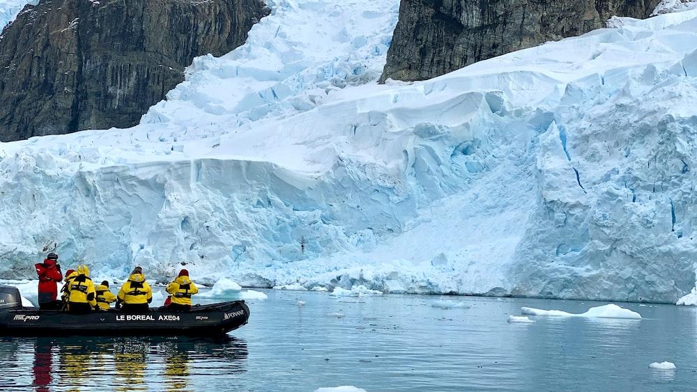person riding yellow kayak on river during daytime