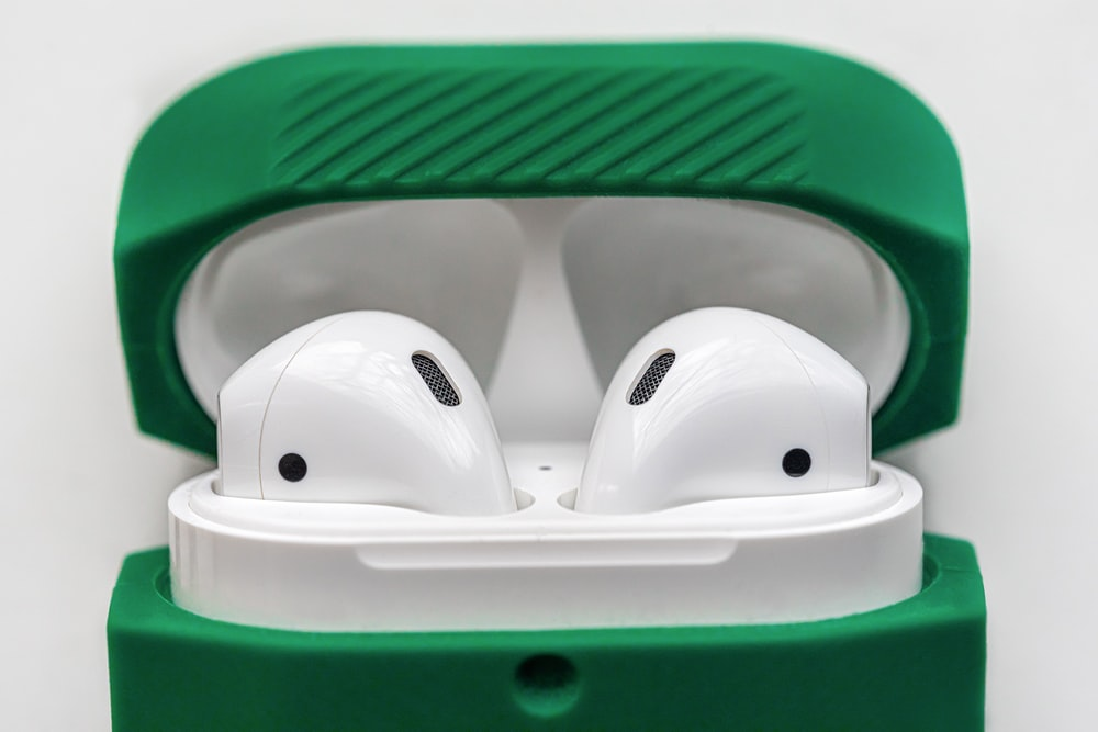 white and green plastic container