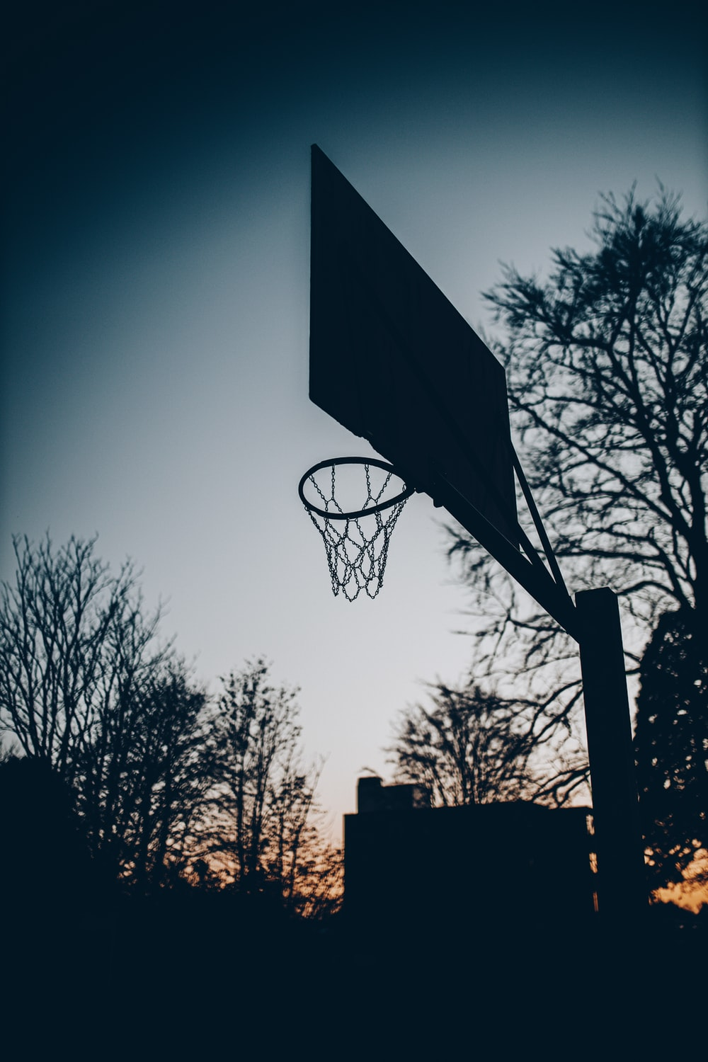 silhouette of basketball hoop during night time