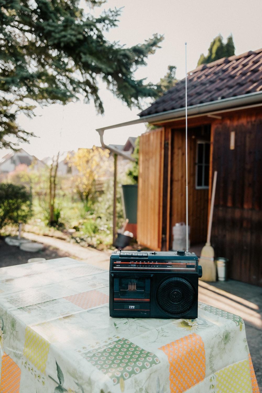 black radio on gray concrete floor