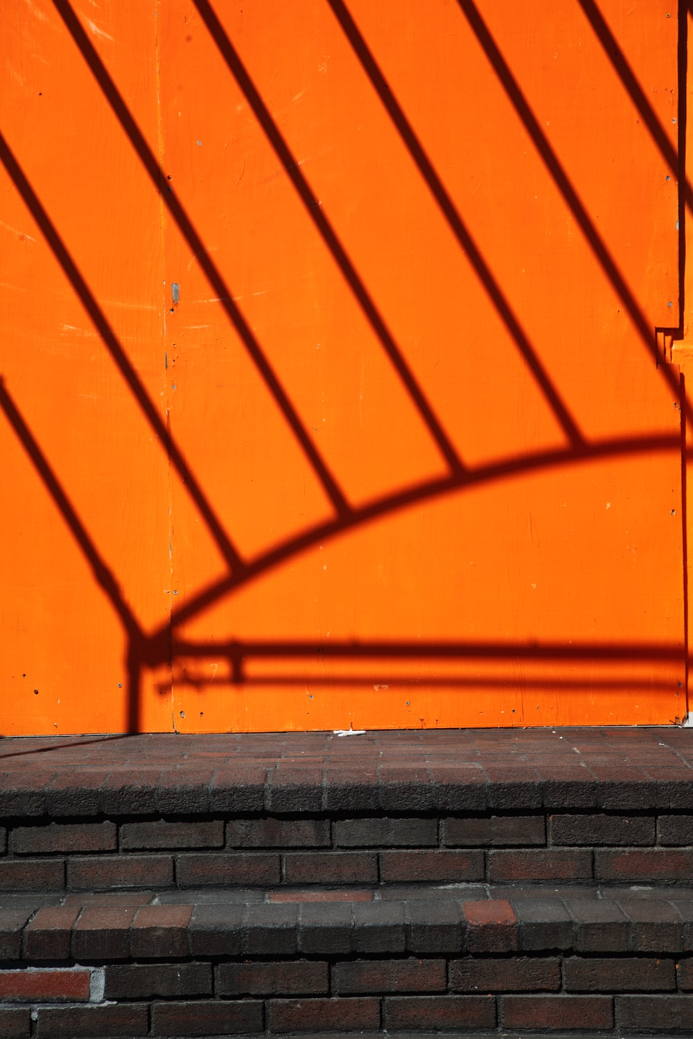 orange wall with shadow of a person