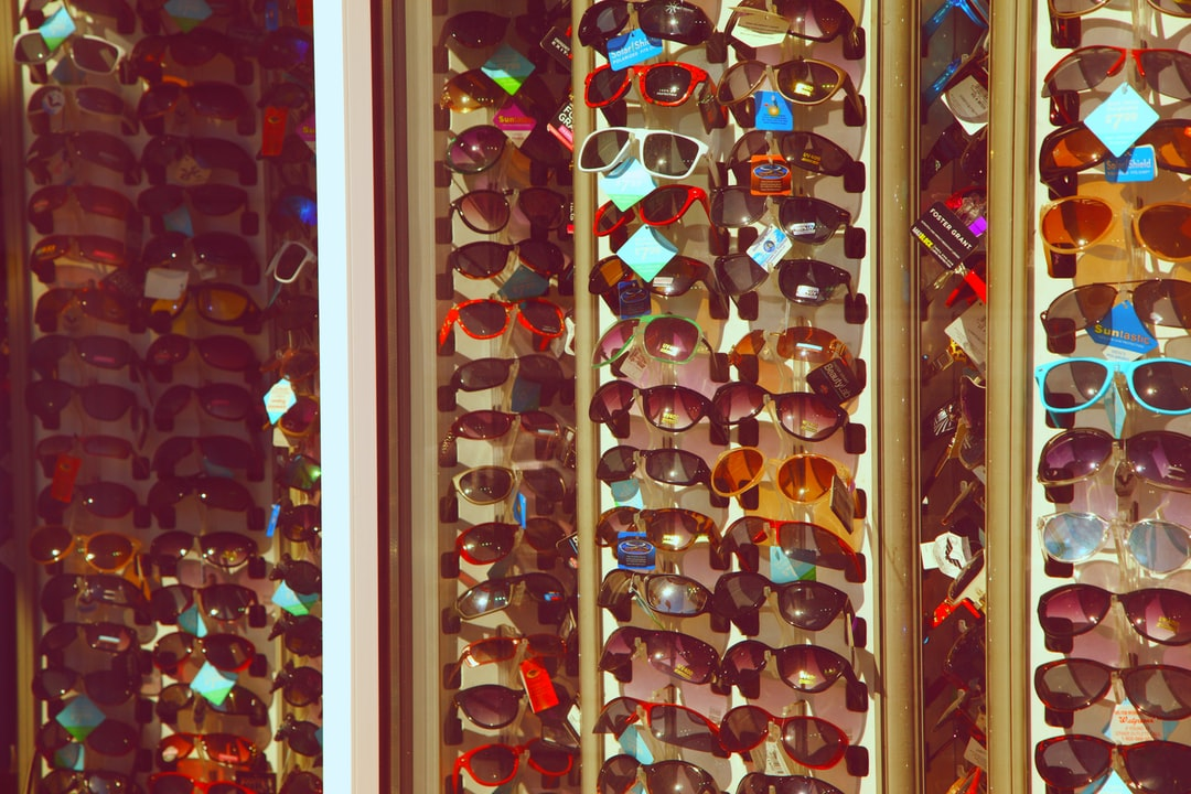 The old Rexall storefront window display on Ocean Boulevard on Hampton Beach, New Hampshire. Full of sunglasses that will probably not sell because of the Covid 19 pandemic. It may be a bad year for the businesses on the beach.