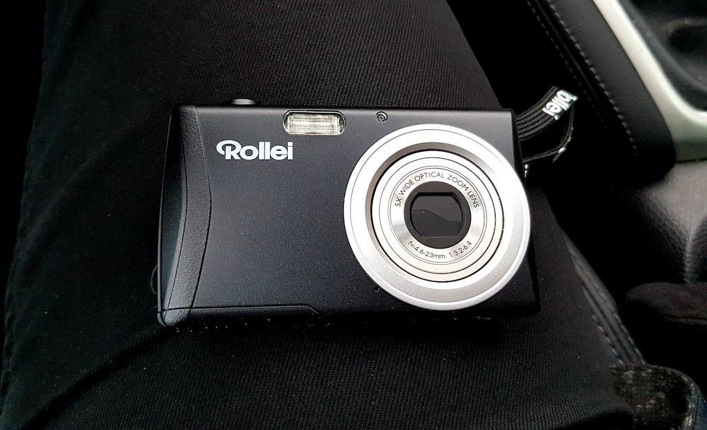 black and silver nikon point and shoot camera