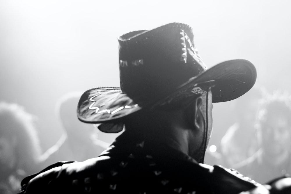 person wearing black cowboy hat