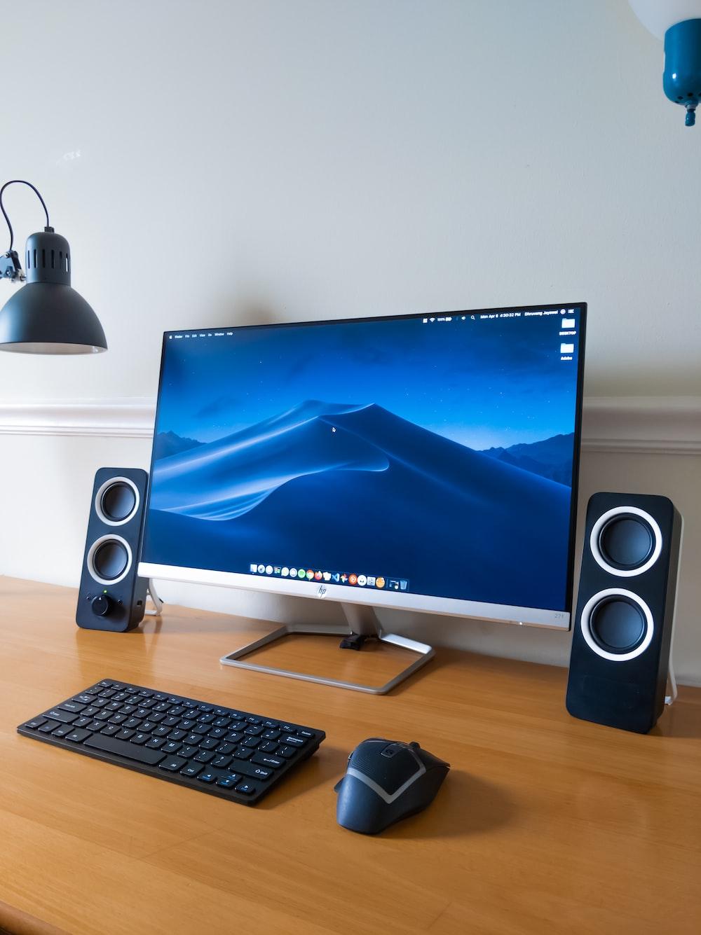 black computer keyboard beside black flat screen computer monitor