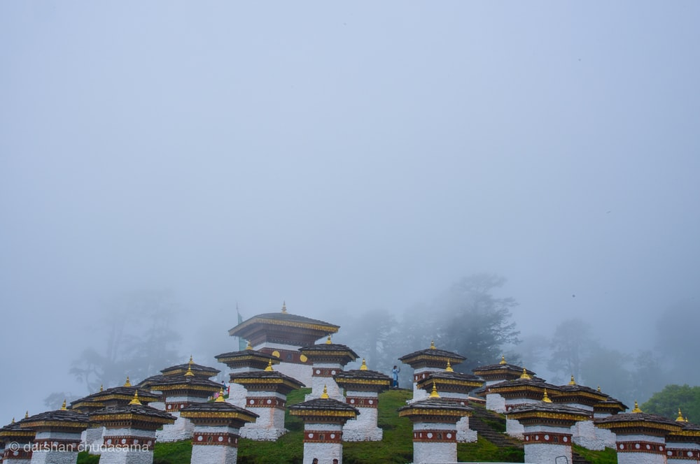 white and green temple under white sky during daytime