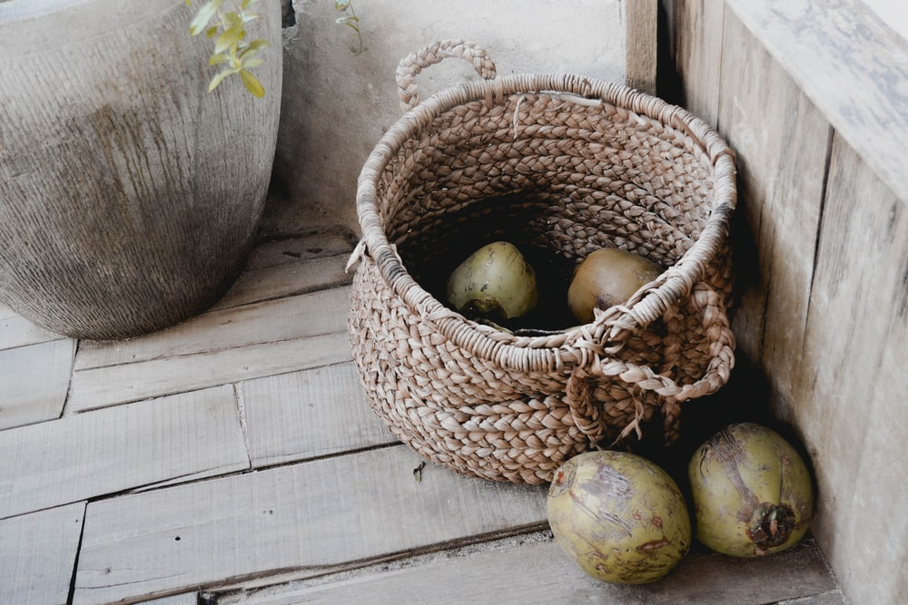 brown woven basket with apple fruits
