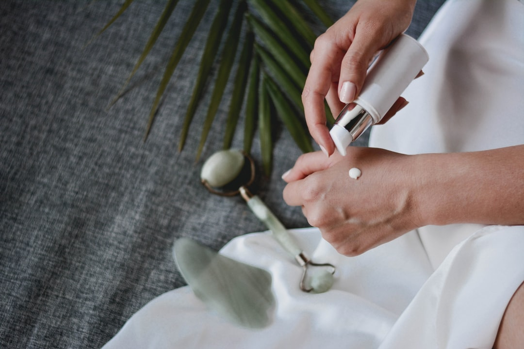 Facial Massage With Gua Sha and Jade Roller - unsplash
