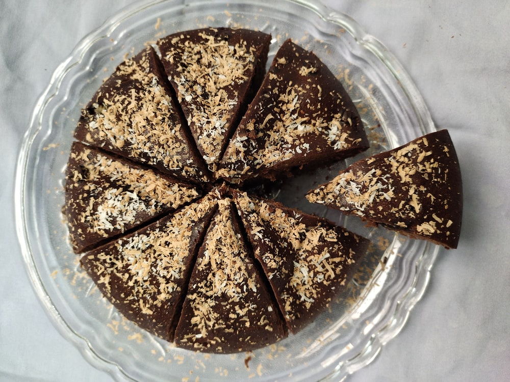 brown chocolate cake on clear glass plate