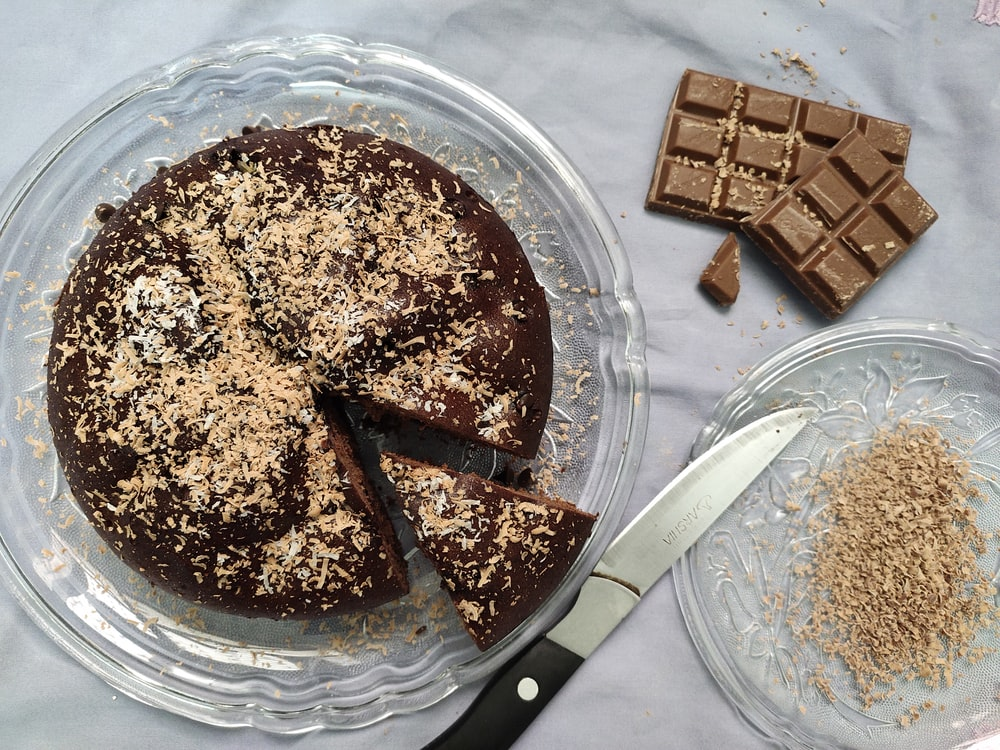 chocolate cake on clear glass plate