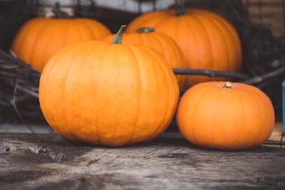 orange pumpkin on gray wooden table pumpkin teams background