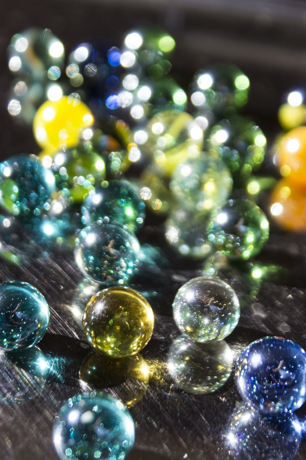 green yellow and blue marble toys
