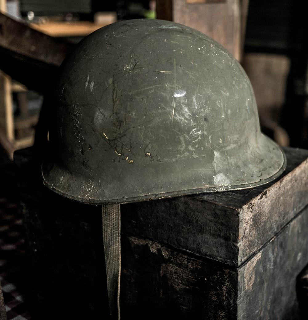 grey helmet on brown wooden table