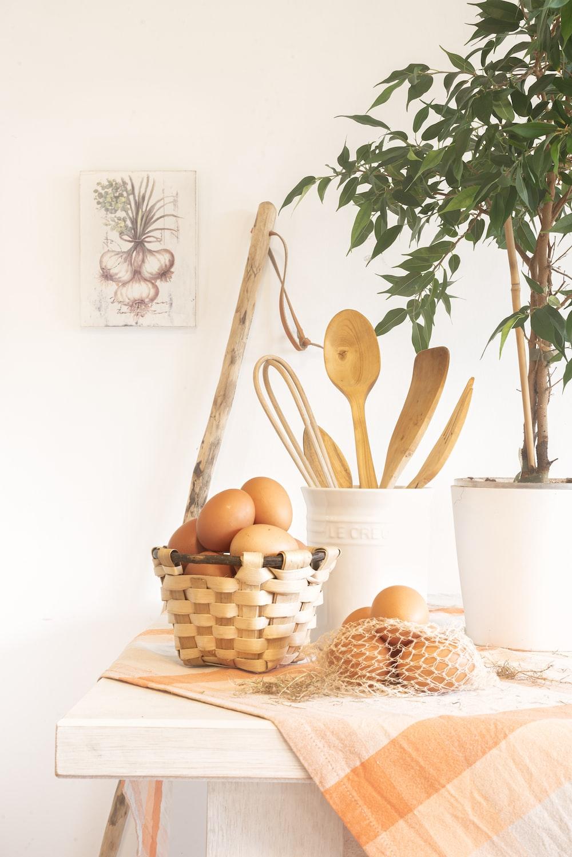 orange fruits on brown wooden basket