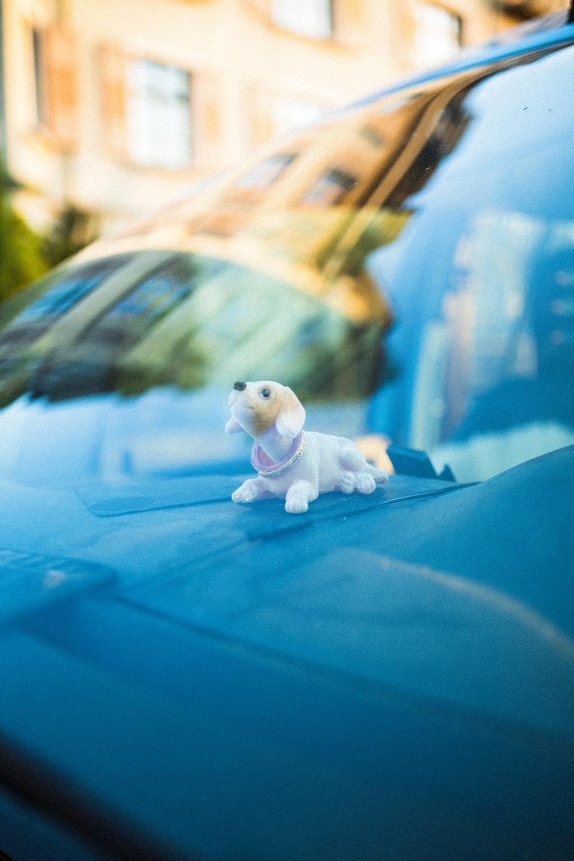 white and brown dog figurine
