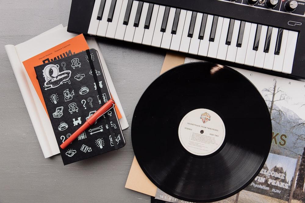black vinyl record on white paper