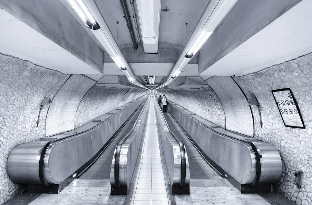 gray concrete tunnel with white light