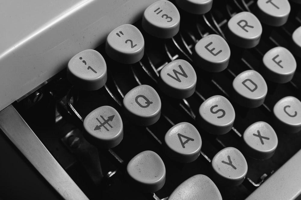 white and black typewriter keyboard