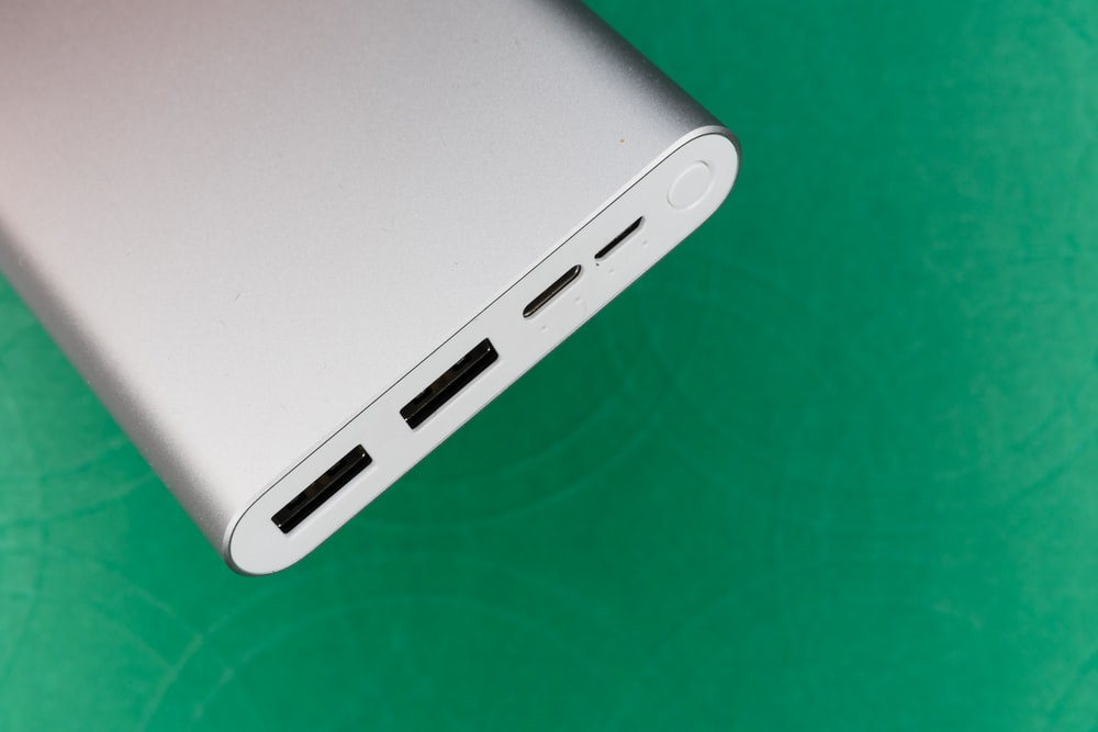 white electronic device on green textile
