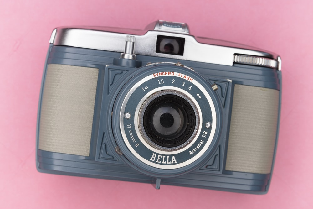 black and silver camera on red textile