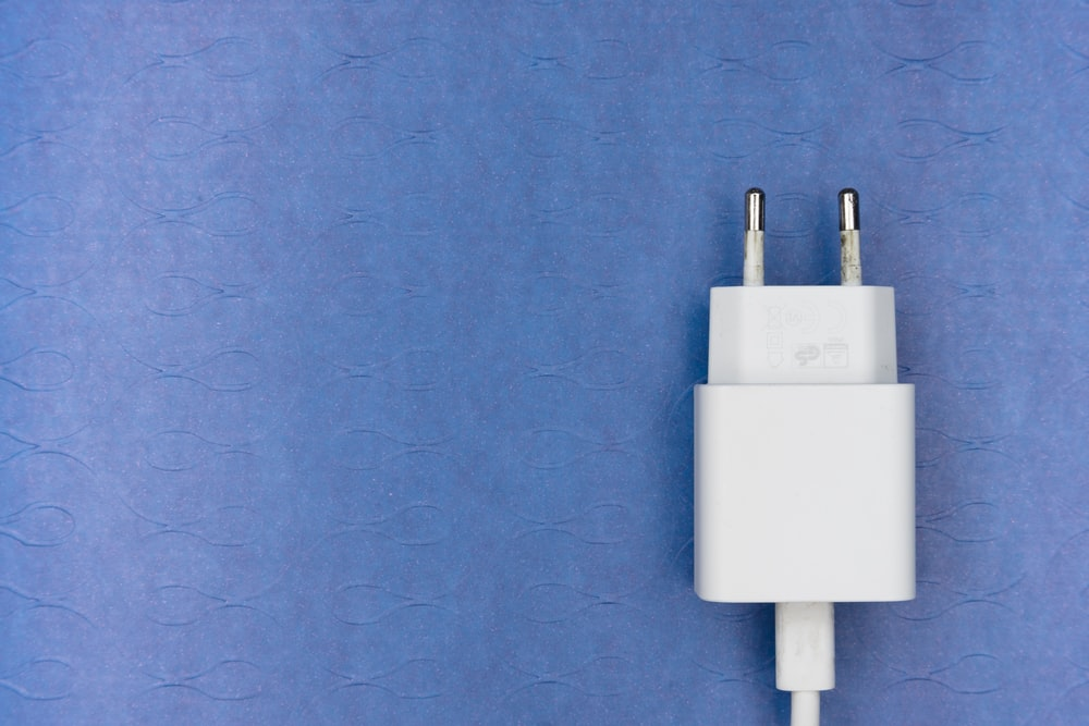 white adapter on purple textile