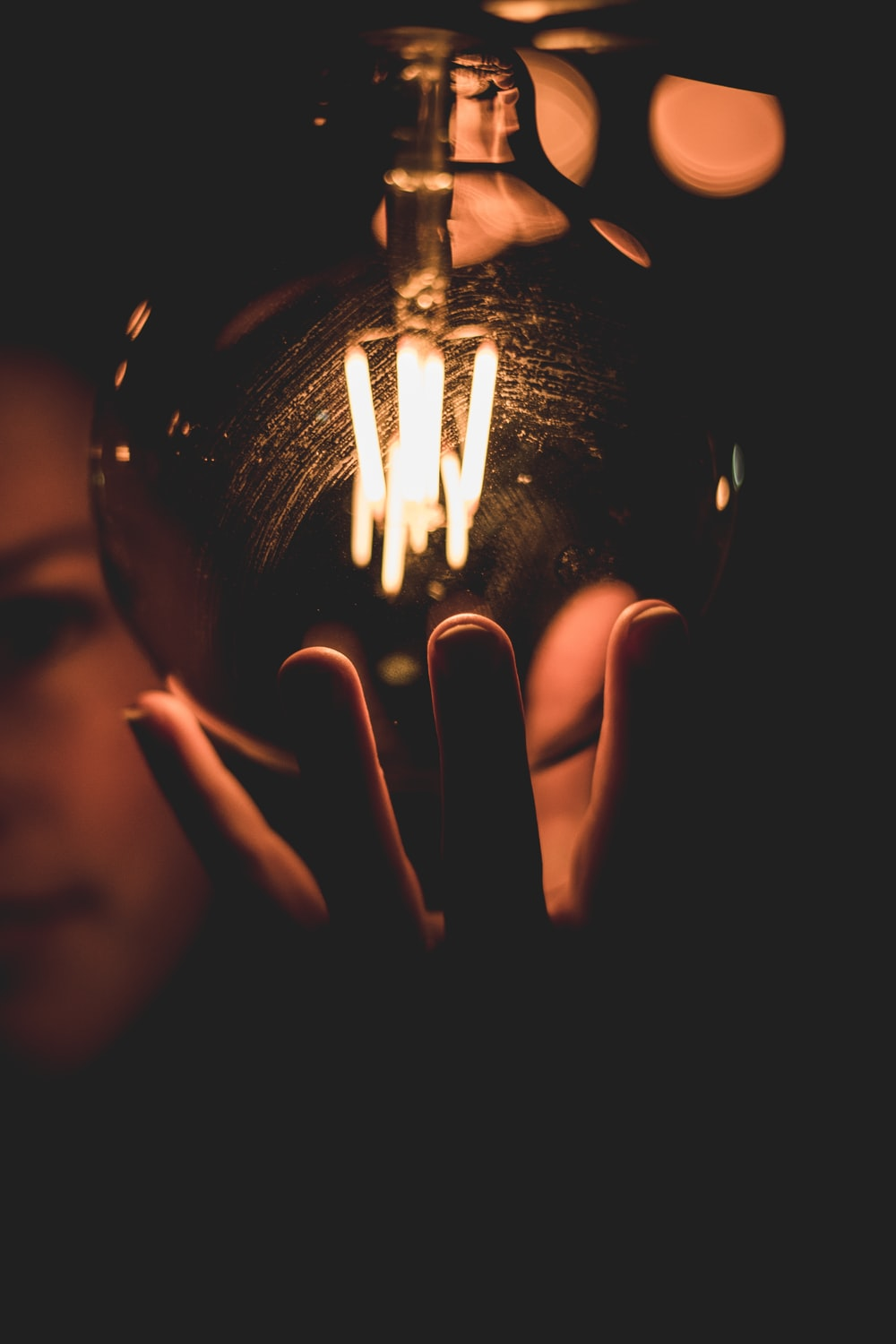 person holding lighted ball with light