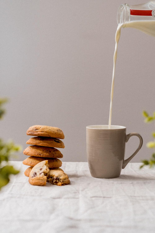 white ceramic mug with white straw