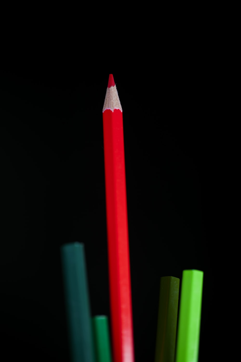 red color pencil on black background