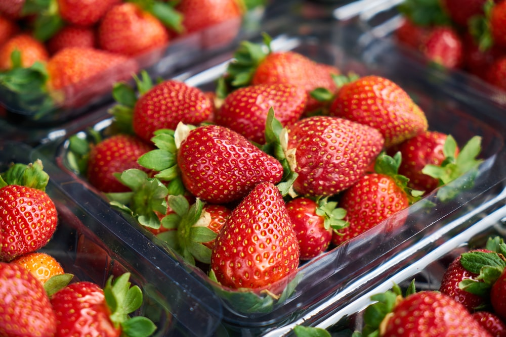 strawberries on clear plastic container