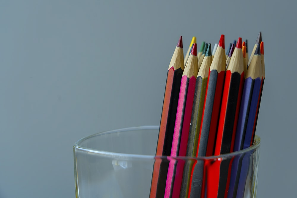 color pencils in clear drinking glass