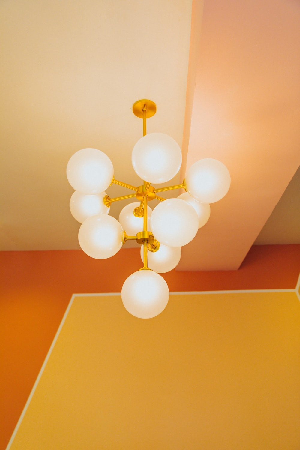 white and gold balloons on ceiling