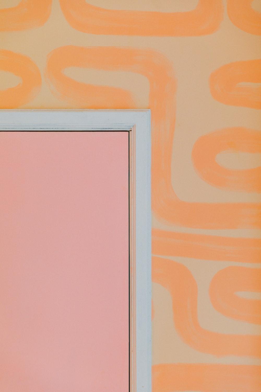 white wooden frame on orange wall