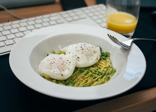 white ceramic plate with green vegetable and egg