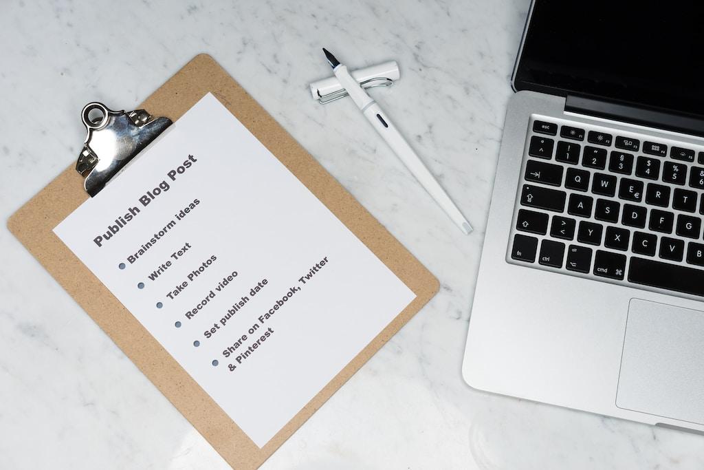 white printer paper beside silver macbook