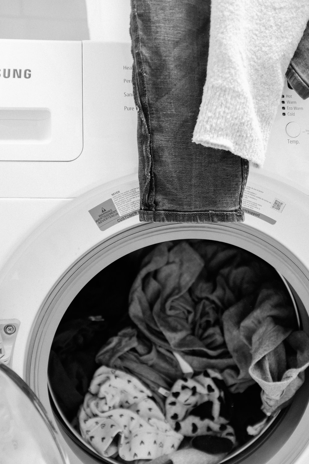 gray and white textile on white front load washing machine